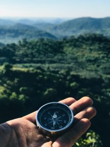 Compass and rolling hills
